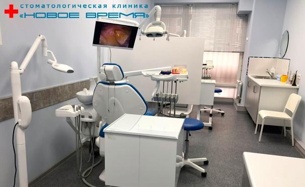 Скидка на Скидка до 90% на УЗ-чистку зубов с АirFlow, отбеливание Amazing White, Zoom 3, лечение кариеса, установку циркониевой коронки, винира, имплантата Alpha Bio или брекет-системы в стоматологической клинике «Новое время»
